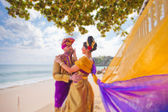 Mature couple dressed in Balinese costume — Stock Photo