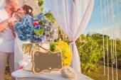 Wedding frame and honeymooners at background — Stock Photo