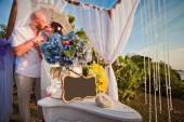 Wedding couple at the beach with frame — Stock Photo