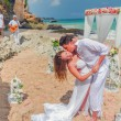 Wedding beautiful couple just married and kissing at beach — Stock Photo #76060495