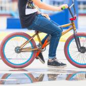 Close-up of teenager on a fashionable bike at outdoor — Stockfoto