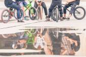 Group of teenagers on a bikes at outdoor — Stock Photo