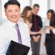 Executive asian boss with his business team at background — Stock Photo #80714440