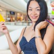 Fashion asian woman holding credit card and bags, shopping mall — Stock Photo #80724354