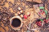 Background of chocolate bar, cup of coffee, hazelnuts, for holiday — Photo