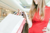 Closeup big bags fashion woman holding at shopping center — Stock Photo