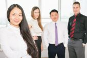 Successful asian business woman with business team — Stock Photo