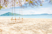 Swing under the tree on the calm beach. — Stock Photo