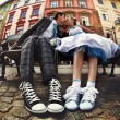 Happy creative wedding couple, with converse sneakers old city b — Stock Photo #69742723