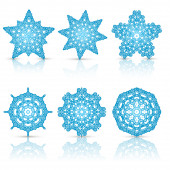 Set of lacy snowflakes — Stock Vector