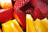 Close up of Oranges and Strawberrys slices . — Stock Photo
