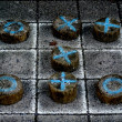 Tic tac toe game on wood pieces . — Stock Photo #71883449