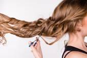 Girl cut her hair — Stock Photo