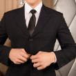 Cropped image of young man buttoning his jacket. successful businessman — Stock Photo #71082807