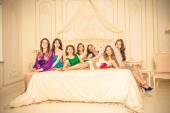Girls celebrate a bachelorette party of bride. bridesmaids fighting pillows — 图库照片