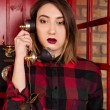 Beautiful young girl in casual style standing in a red telephone — Stock Photo #75974277