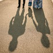 Family walking with baby. image of family's shadows — Stock Photo #75974343
