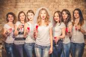 Cheers! girls celebrate a bachelorette party of bride. — Stock Photo