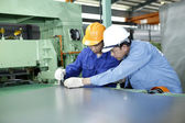 Two workers are working in a mechanical workshop — Stock Photo