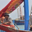 ������, ������: Nha Trang Vietnam March 15 2012: Fishermen on a fishing boat are ready to go offshore for a better source of fishes