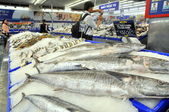 Ho Chi Minh city, Vietnam - October 8, 2013: Many kinds of fish are for sale in a modern supermarket in Vietnam — Stock Photo