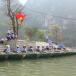 Ninh Binh, Vietnam - March 29, 2010: Ferrymen are waiting for tourists to visit the Trang An Eco-Tourism Complex, a complex beauty - landscapes called as an outdoor geological museum — Stock Photo #76675581