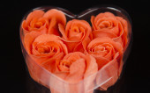 Rose petals in heart — Stock Photo
