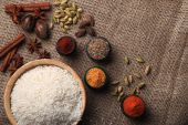 Rice and spices. Burlap background. Top view — Stock Photo