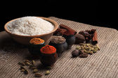 Rice and spices. Black background — Stock Photo