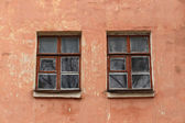 Windows on the wall of an old house — Stock Photo