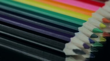 Colored Pencils Rotating on a Black Table. — Stock Video