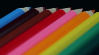 Colored Pencils Twelve Pieces Lie on a Black Table — Stock Video