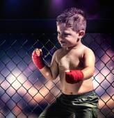 Child boxer in shorts and bandages on hands — Stock Photo