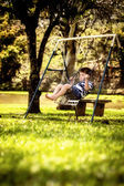 Boy on a swing in the park — Stock Photo