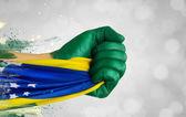 Brazilian fan patriot with flag — Stock Photo