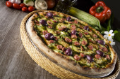 Pizza lifted slice with pepper and zucchini — Stock Photo