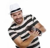 Happy man in colorful shirt with tambourine — Stock Photo