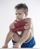 Child boxer in shorts and bandages — Fotografia Stock