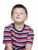 Child blinking his eye — Stock Photo