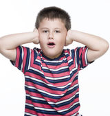 Boy covers his ears with his hands — Stock Photo