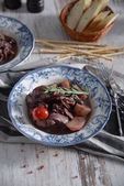 Rabbit in red wine with prunes — Stock Photo