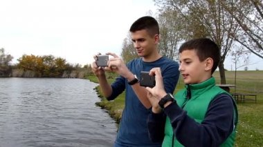 Two boys taking photos with their smart phones — Video Stock