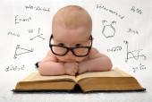 Little baby in glasses with eauations around — Stock Photo