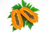 Haft cut papaya fruit and papaya leaf isolated over white background — Stock Photo