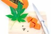 Sweet papaya slice on chopping bord isolated on white background — Stock Photo