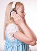 Teenage girl is listening to music — Stock Photo