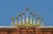Golden metal tiered umbrella — Stock Photo