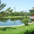 Green park filled and lake — Stock Photo #71420031