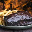 Pork ribs back with french fries — Stock Photo #70437367