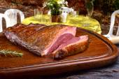 Roast picanha on wooden board — Stock Photo